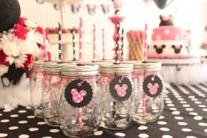 "Minnie Mouse Mason Jars! Pick up rubber grommets at your local hardware store that have an opening of 5/16"". That opening fits the average straw size. Drill a hole in the top of the lid and insert grommet. Don't forget to put a small air hole in the lid as well :)"